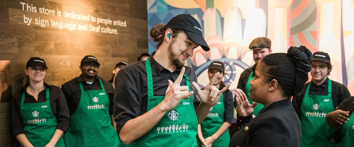 Starbucks employees training one another